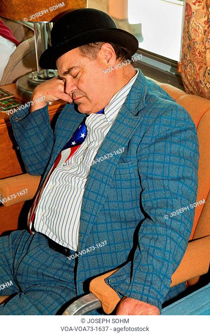 1940's reenactor of Lou Costello sleeps on Pearl Harbor Day Troop train reenactment from Los Angeles Union Station to San Diego