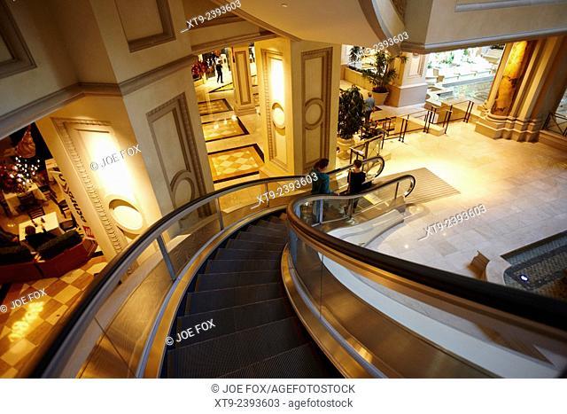 circular escalator at the forum shops at caesars palace luxury hotel and casino Las Vegas Nevada USA