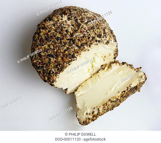 Boursin au Poivre, Round block of boursin, a white, smooth soft cheese with buttery texture, encrusted with a mixture of French herbs and peppers
