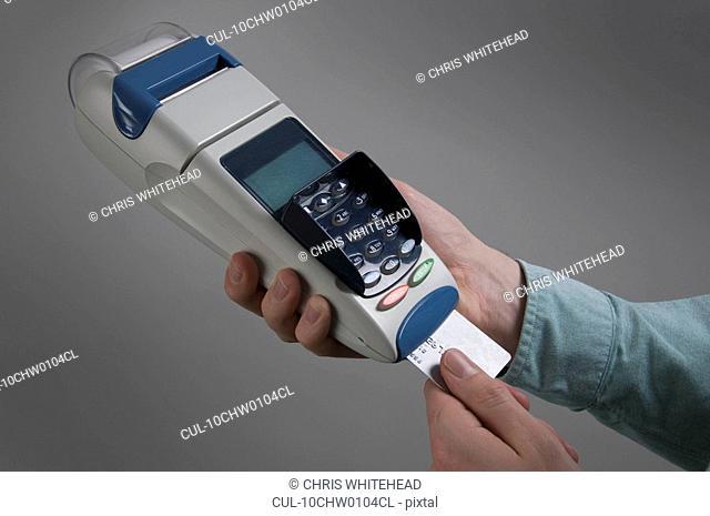 Male holding credit card machine