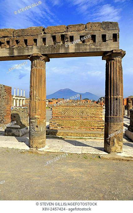 Forum colonnade by the Public Administration buildings with Mount Vesuvius in the distance, Pompeii, Italy