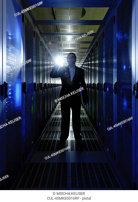 Businessman walking in server room