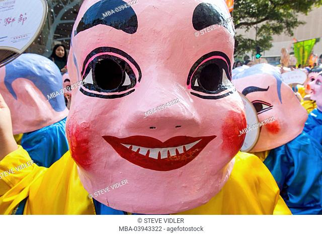 China, Hong Kong, Annual New Years Day Festival Parade, Children Dressed in Happy Buddha Masks
