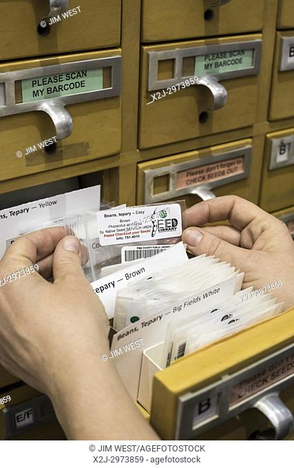 Tucson, Arizona - The Pima County Public Library maintains a seed collection in an old card catalog file. Gardeners can check out seeds