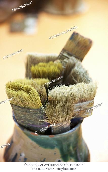 Group of brushes in an artist's workshop
