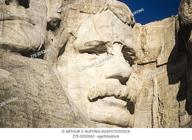 Close-up of granite sculpted face of President Theodore Roosevelt. Mount Rushmore National Memorial, Black Hills, Keystone, South Dakota, U. S. A