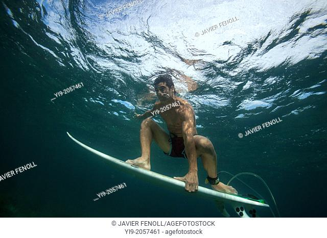guy surfing under water