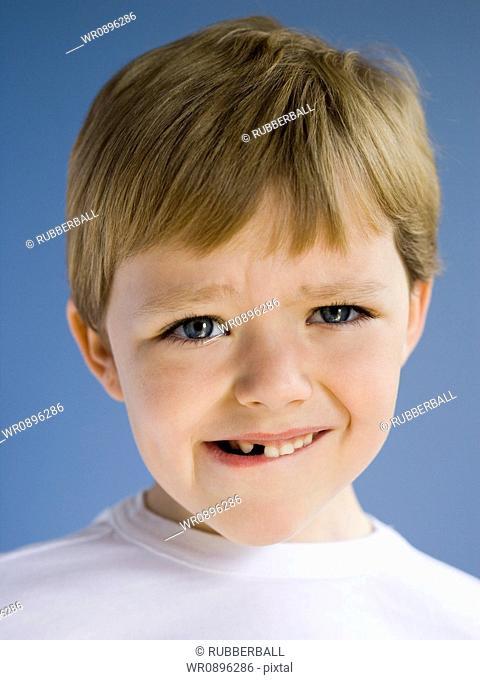 Closeup of boy biting lip
