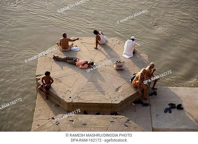 People on ghats of ganga ganges river in Varanasi ; Uttar Pradesh ; India