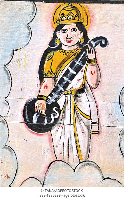 Wall painting of God at ghat by the Ganges river