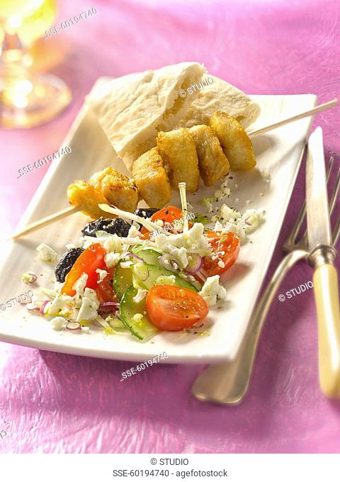 Grilled chicken brochette ,Greek salad and pitta