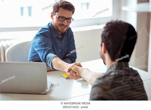 Business people greeting eachother