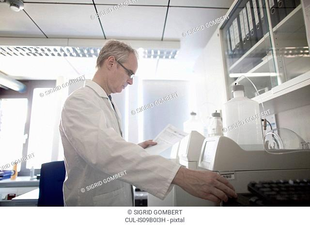 Male meteorologist reading data from weather station laboratory