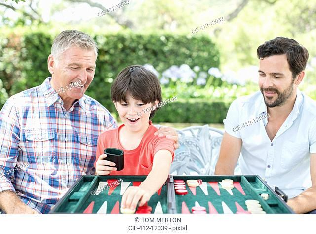 Men playing backgammon outdoors