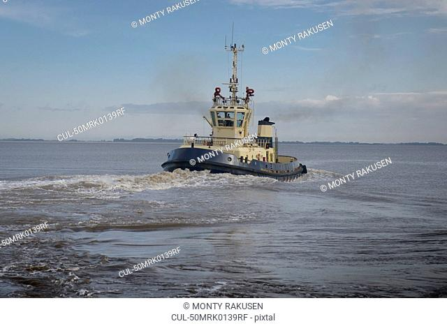 Tugboat sailing in water