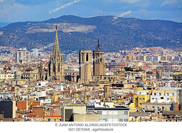 Partial view of Barcelona. The towers of Santa Maria del Mar Basilica stand out in the center and the main tower of the cathedral can be seen on the left