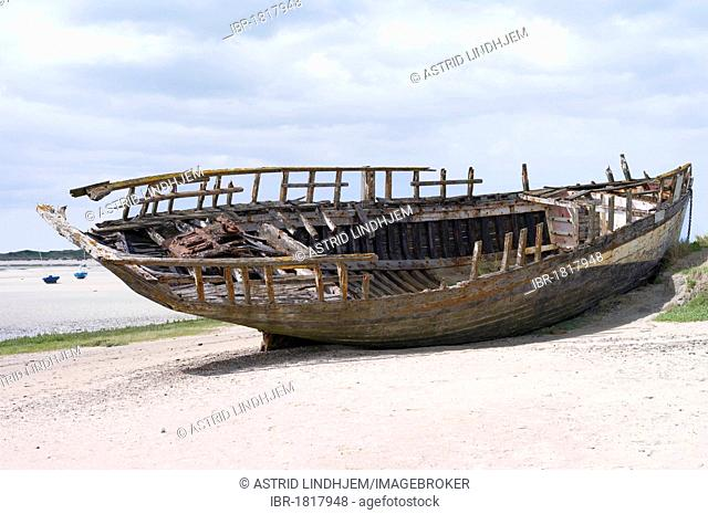 Wreck, wooden boat stranded on the beach