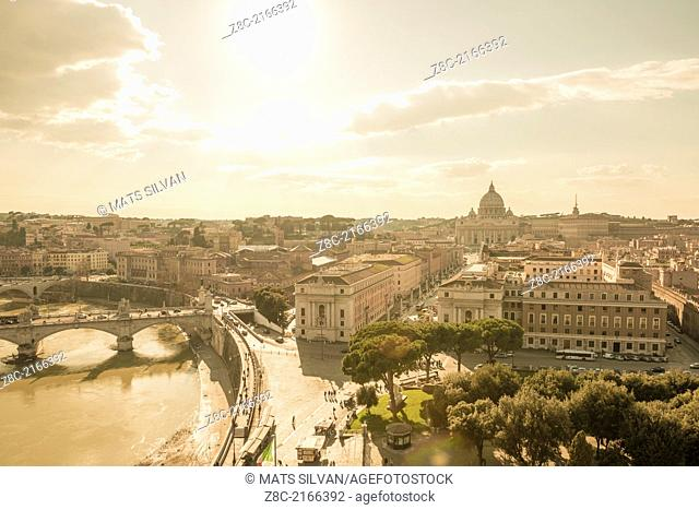 Panoramic view over river Tiber and Vatican city with sunshine in Rome Italy