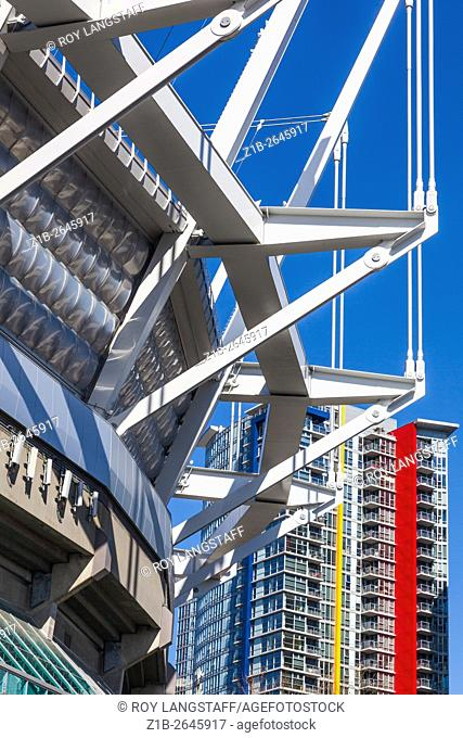 Abstract image of a stadium structure and colourful apartment building