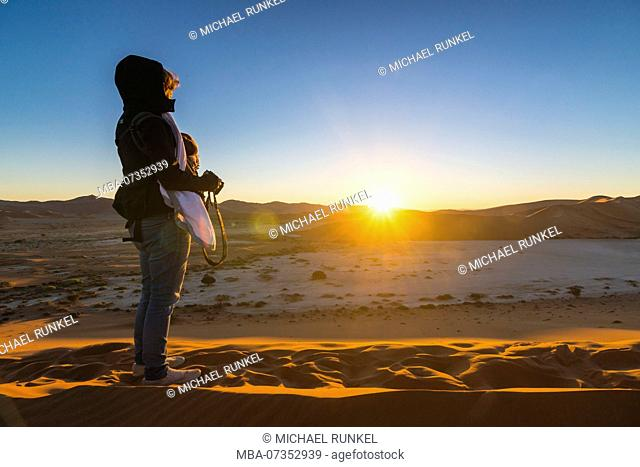 Photographer at Deadvlei, an old dry lake in the Namib desert, Namibia