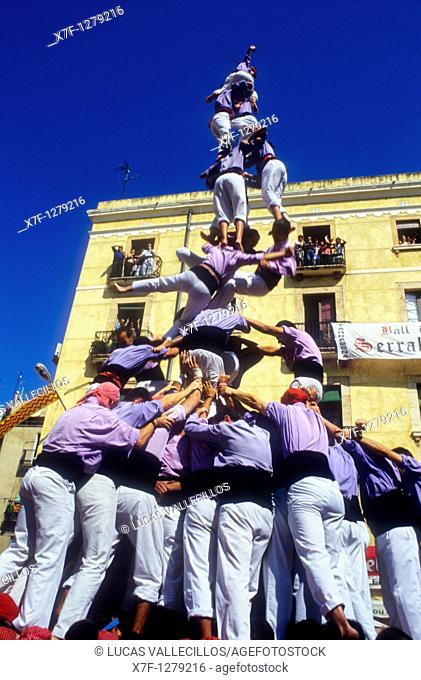 Jove Xiquets de Tarragona Human tower falling 'Castellers' building human tower, a Catalan tradition Diada de Santa Tecla  Plaça de la Font Tarragona,Catalonia