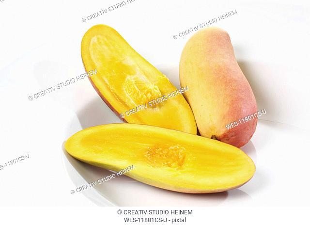 Sliced Mangos Mangifera indica on plate