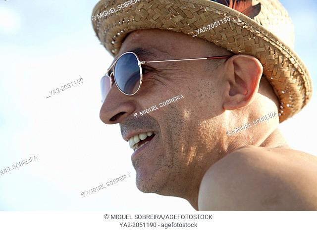 Man With hat and Glasses on Beach Portrait