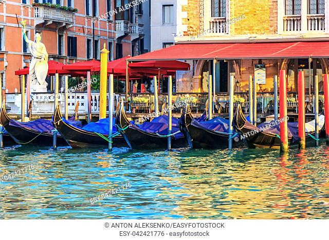 Street cafe and gondolas in Venice Channel