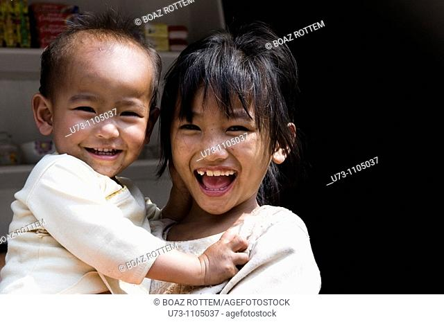 Siblings happy together. photo taken in Yunnan, China