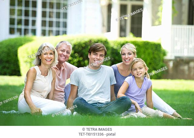Portrait of girl 10-11 with parents and grandparents