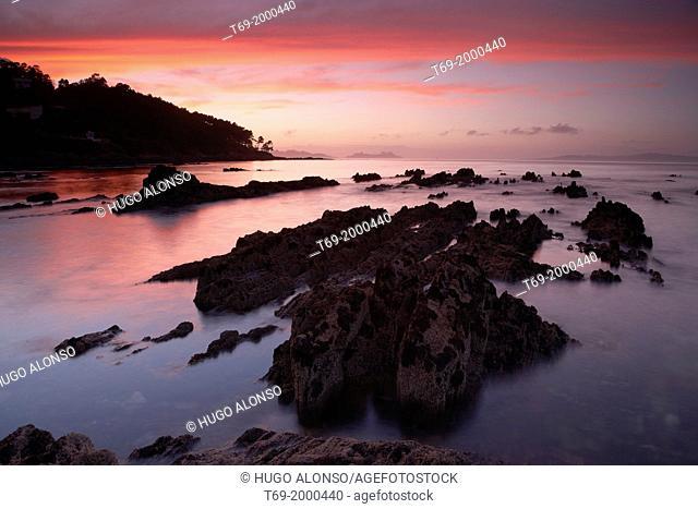 Sunset in the Vigo sea inlet. Cies islands on the background. Pontevedra. Galicia. Spain
