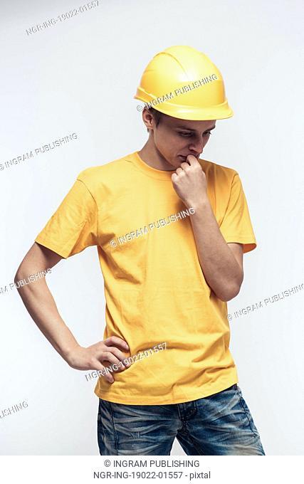 Worker in yellow helmet upset