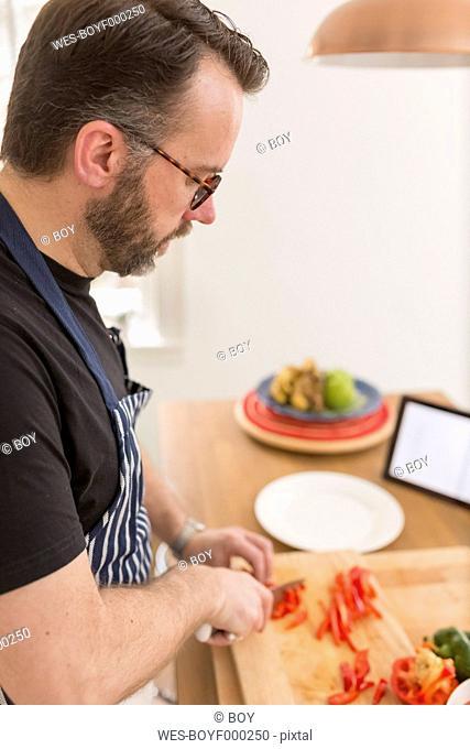 Man preparing vegetables in the kitchen