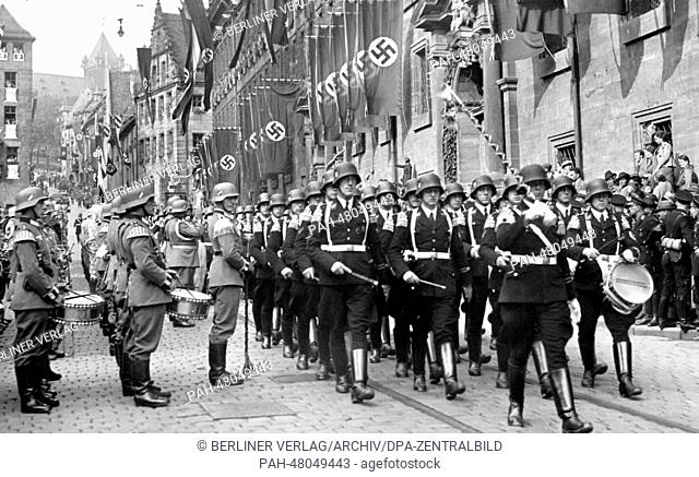 Nuremberg Rally 1938 in Nuremberg, Germany - March to the city hall for the reception of Adolf Hitler. (Flaws in quality due to the historic picture copy)...