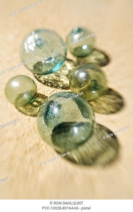 Green glass fishing balls on the beach