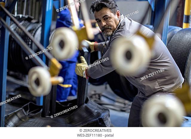 Tire repairman working in factory