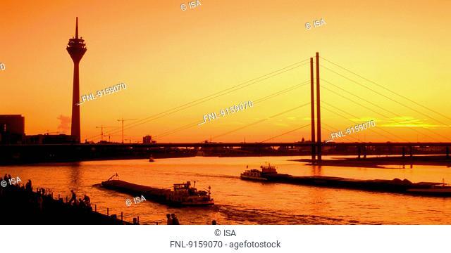 River Rhine, bridge and TV tower at sunset, Dusseldorf, Germany