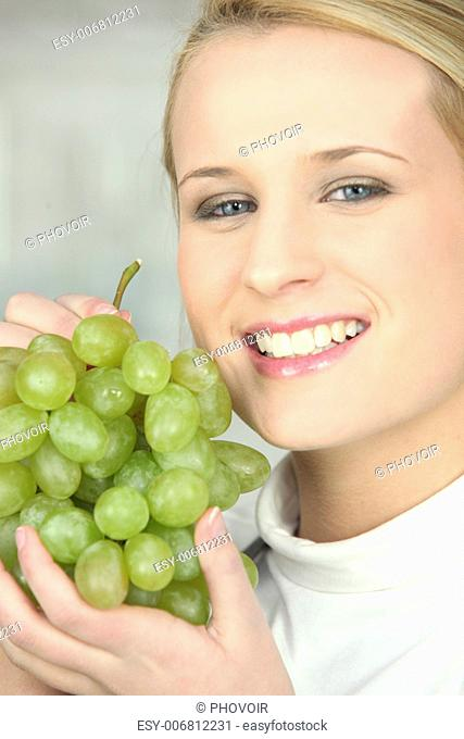 Young Woman Holding Bunch Of Grapes Stock Photos And Images