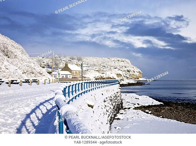Benllech, Isle of Anglesey, North Wales, UK, Europe  Snow on the seafront and beach in winter