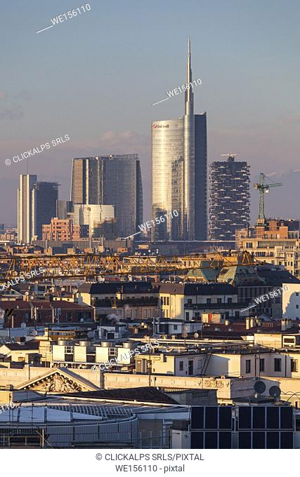 Milan, Lombardy, Italy. A view of city from the top of Cathedral at sunset