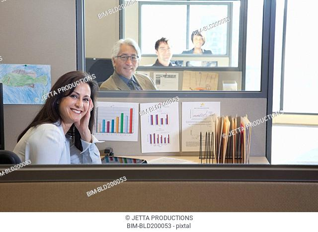 Business people sitting in cubicles
