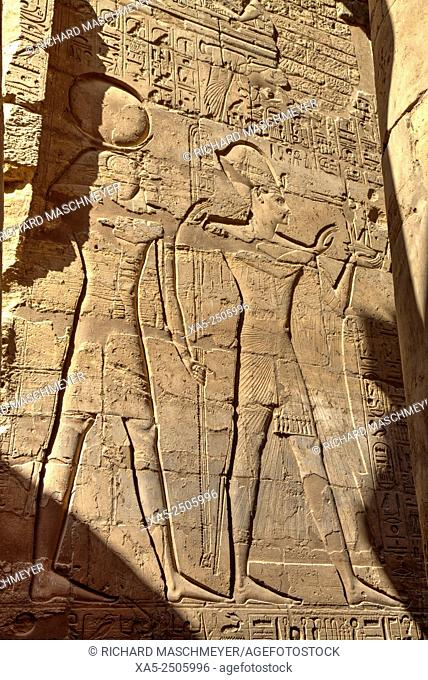 Bas-relief of the God Horus (left) and a Pharaoh (right), Luxor Temple, Luxor, Egypt
