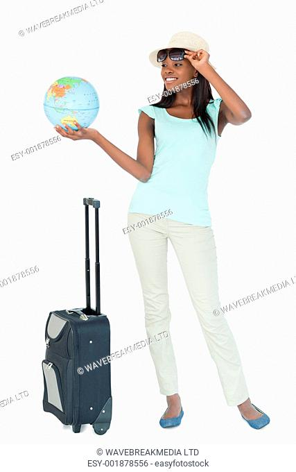 Young woman doing a trip around the world against a white background