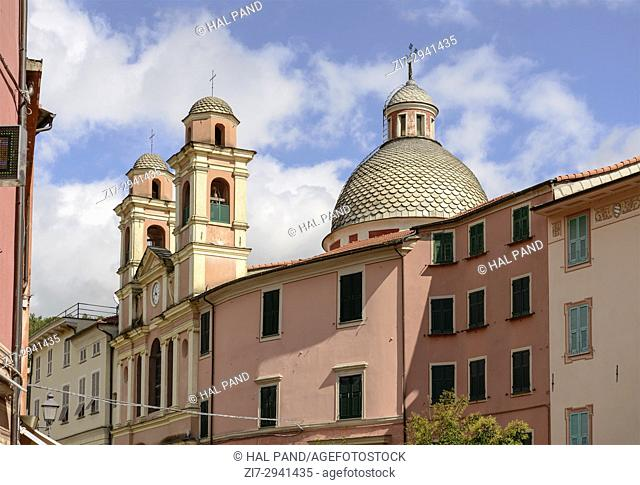 foreshortening of bell towers and dome of saints Filippo and Teresa ancient church, shot in bright late summer light at Varese Ligure, Genova, Liguria, Italy
