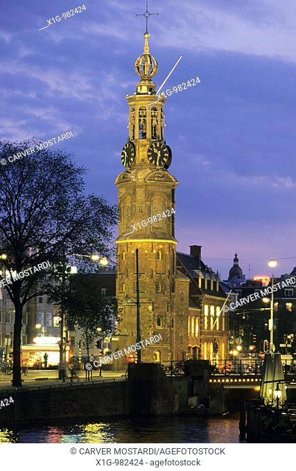 The Muntplein and Munttoren tower seen from the Amstel river in Amsterdam, Netherlands