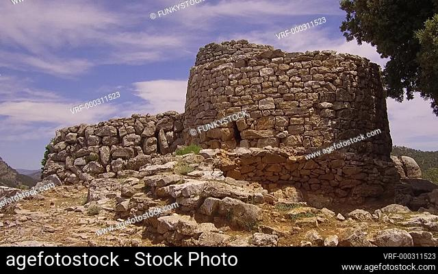 Nuraghe Serbissi, Osini, Sardinia : zoom out see Bronze age ruins of a Nuraghe tower and Nuragic Village