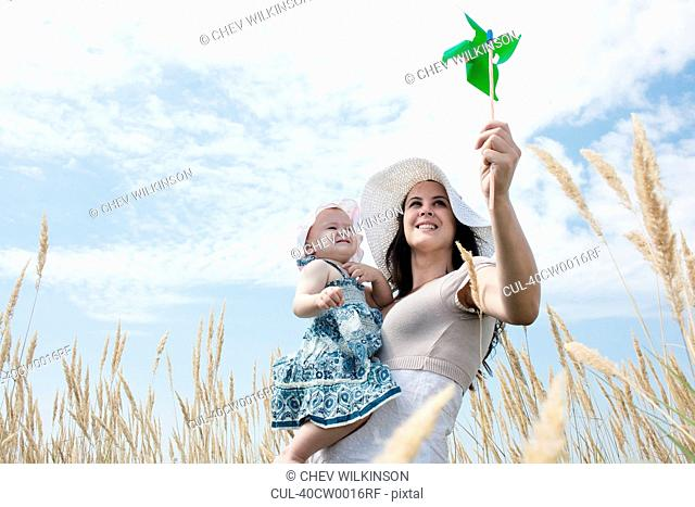 Woman holding pinwheel for daughter