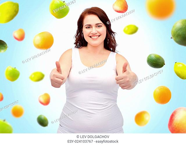 weight loss, diet, slimming, healthy eating and people concept - smiling young plus size woman in underwear showing thumbs up over blue background with fruits