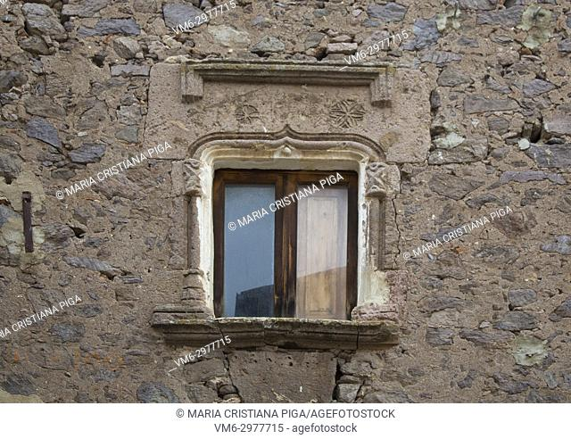 an old window with a 15th century stone architrave in the old village of Bortigali, Sardinia, Italy