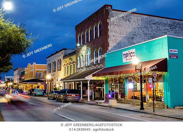 Florida, Kissimmee, Historic Downtown Kissimmee, Main Street, dusk, business district, storefronts, restaurant, evening, night, businesses